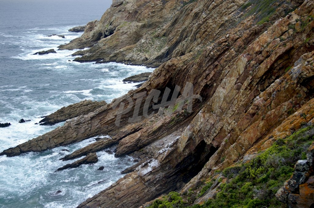 Rocky sea cliffs and caves