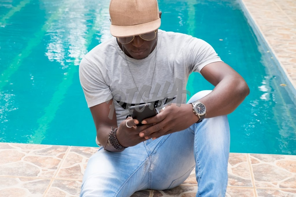 Man checking phone by the pool