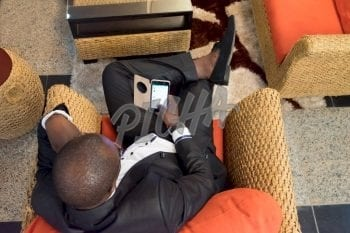 Business man looking at his phone