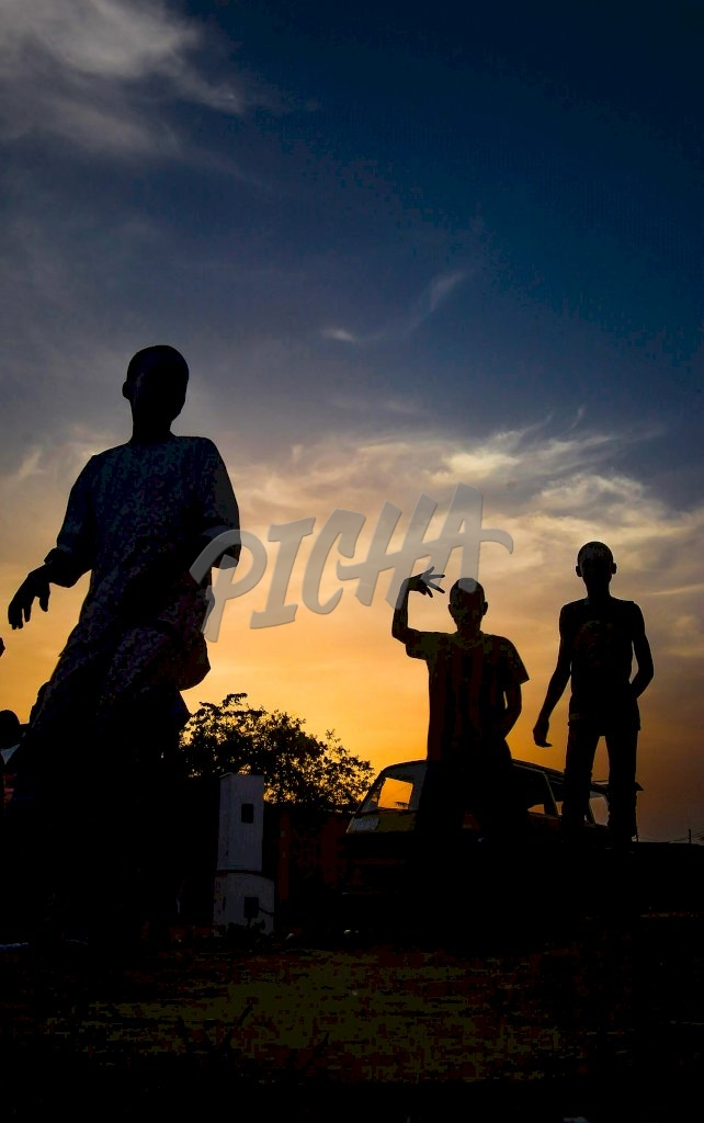 Slihoutte of kids playing in Lagos