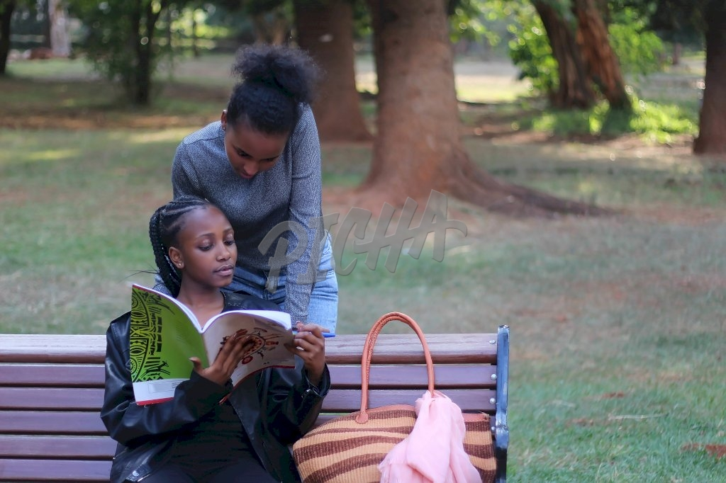 Two women reading and studying together