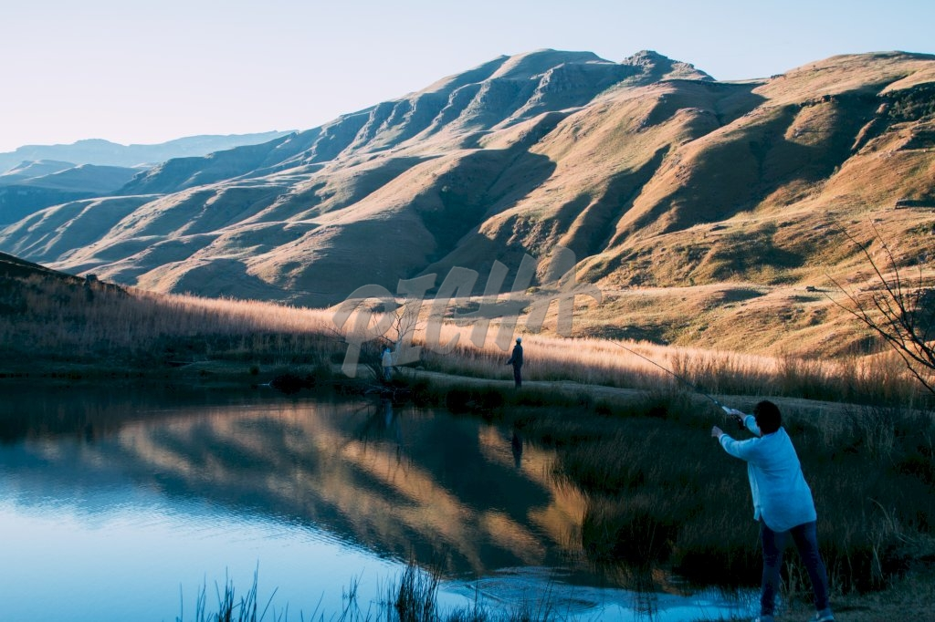 Woman fishing in Lotheni reserve, South AfricaLotheni reserve, South Africa