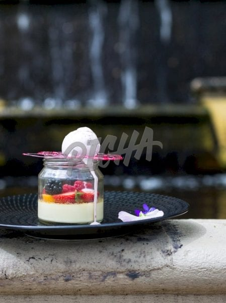 Cream and fruits in a jar