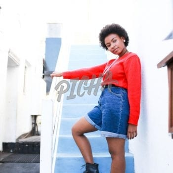 Afro woman wearing a red shirt