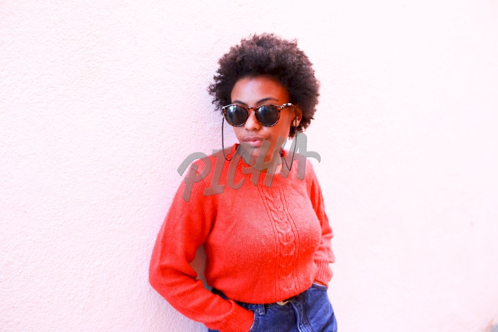 Afro hair woman in red sweater