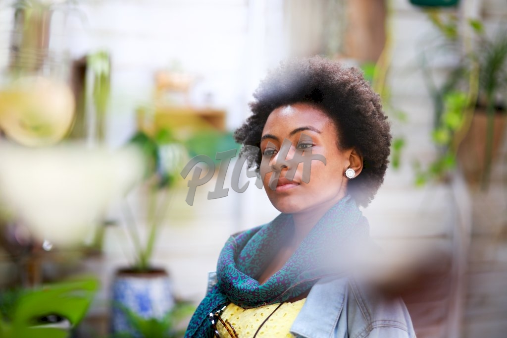 Afro woman lost in thoughts