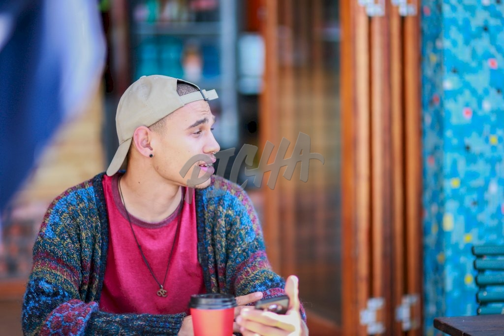 Young man at a coffee shop