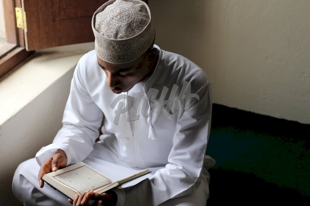 Young man reading the Quran