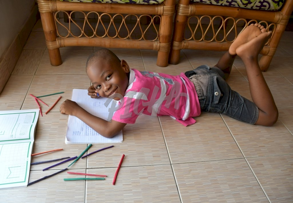 smily child drawing on the floor