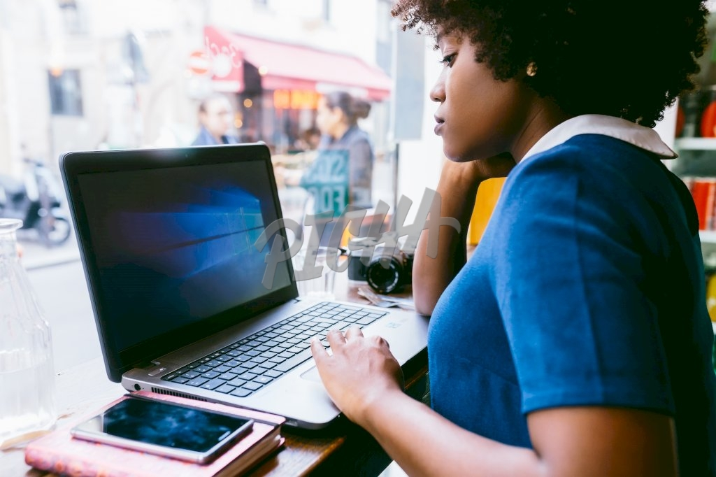 woman working from a coffee shop