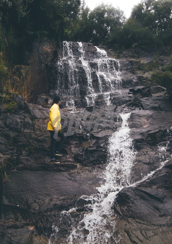 Man standing over a waterfall