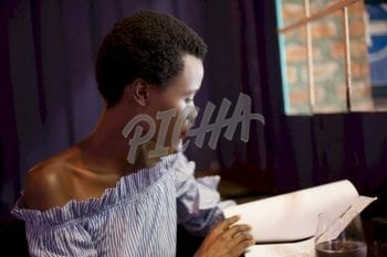 Afro woman going over some documents