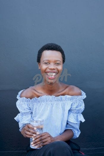 Smily woman holding a glass of water