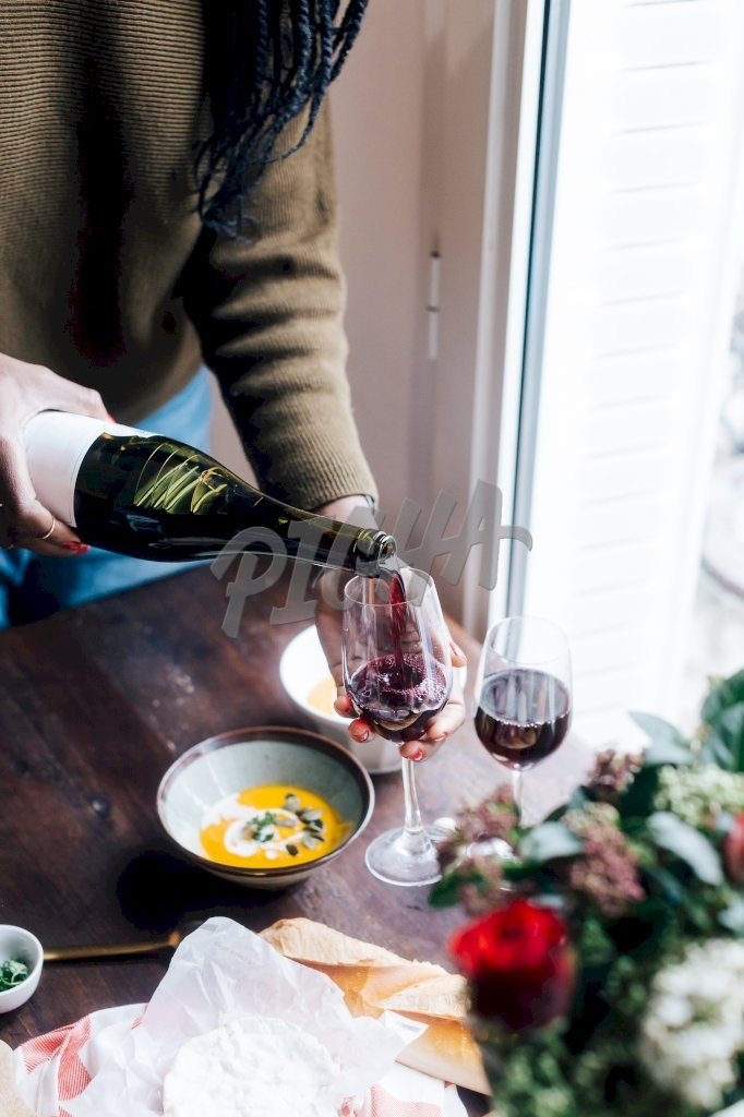 Pouring wine for diner