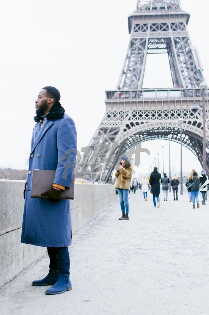 Professional man by the Eiffel Tower, Paris- France