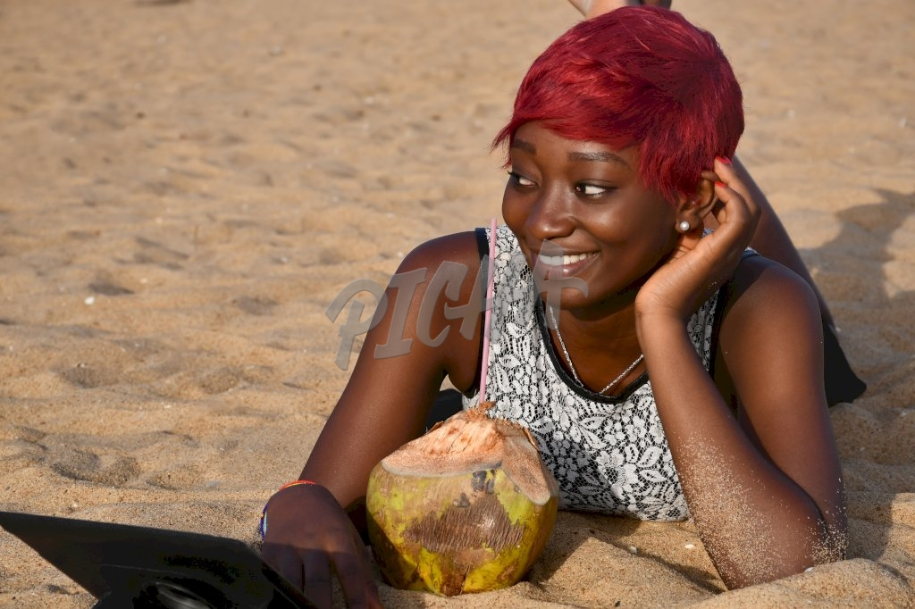 woman smiling at the beach in Lome, Togo