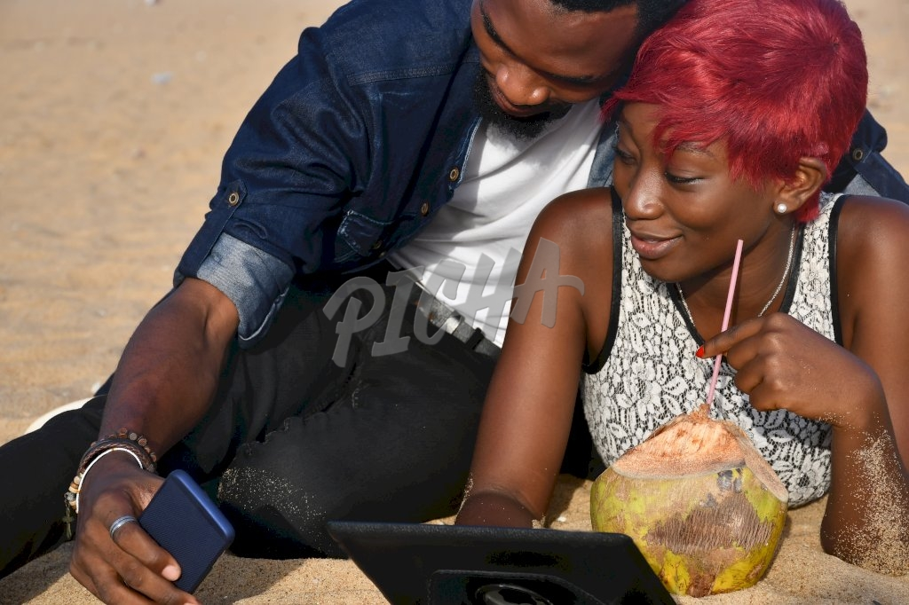 couple taking a selfie by the beach in Lome, Togo