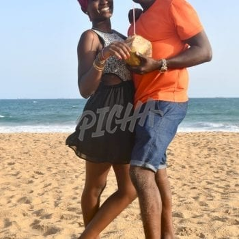 Friends having fun by the beach in Lome, Togo