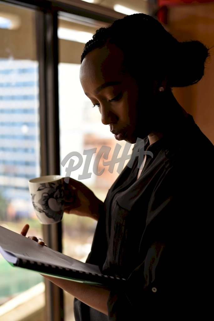 Young woman working in an office in Nairobi, Kenya
