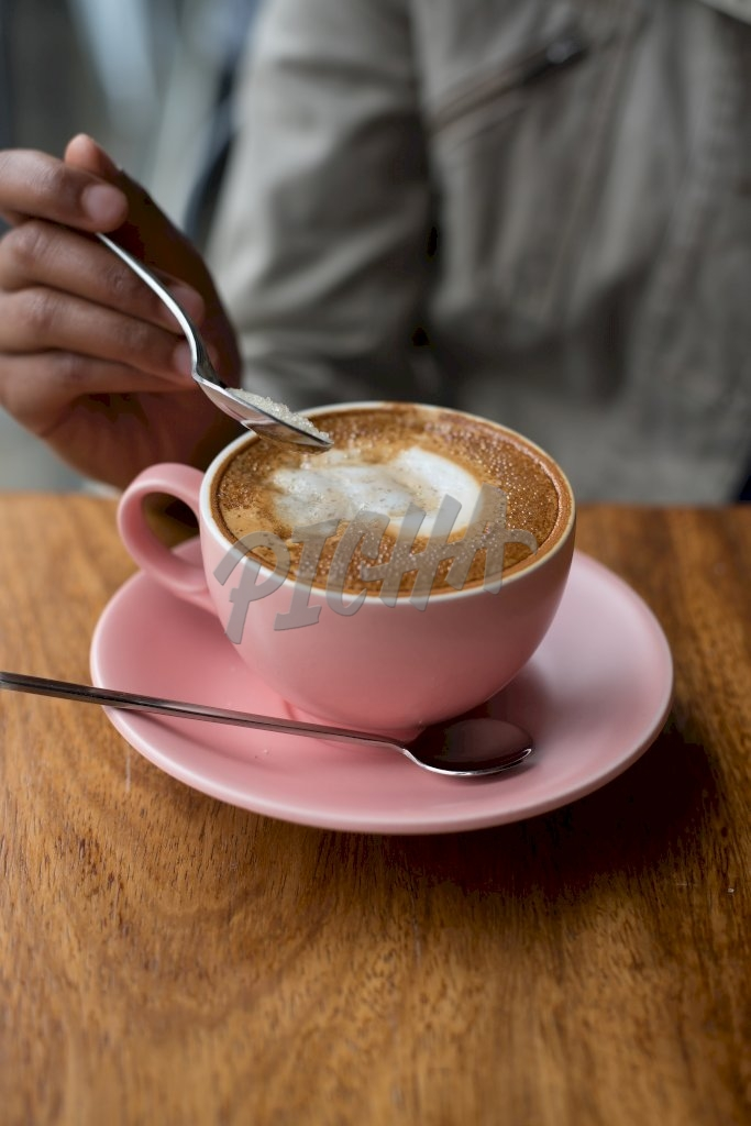 A cup of latte in a pink cup