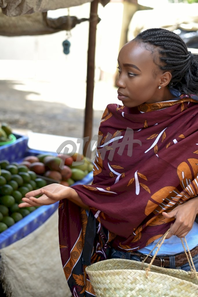 Woman, getting some vegetables and fruits from the market in Kenya