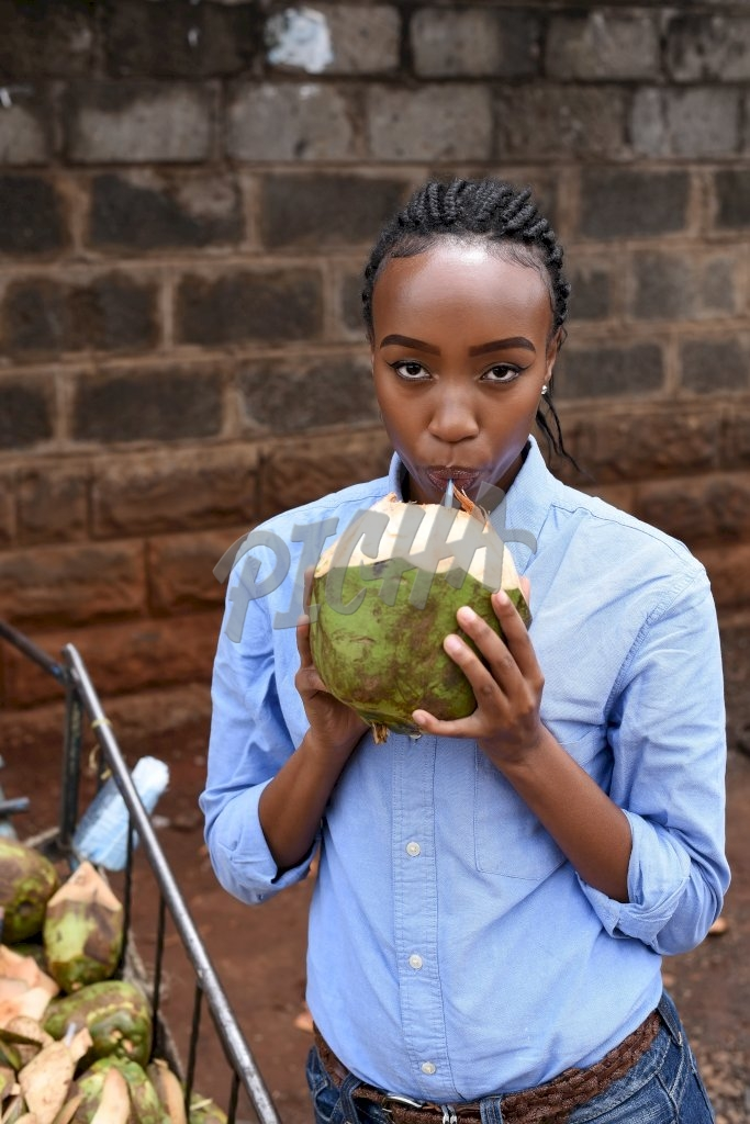 Woman getting some coconut water