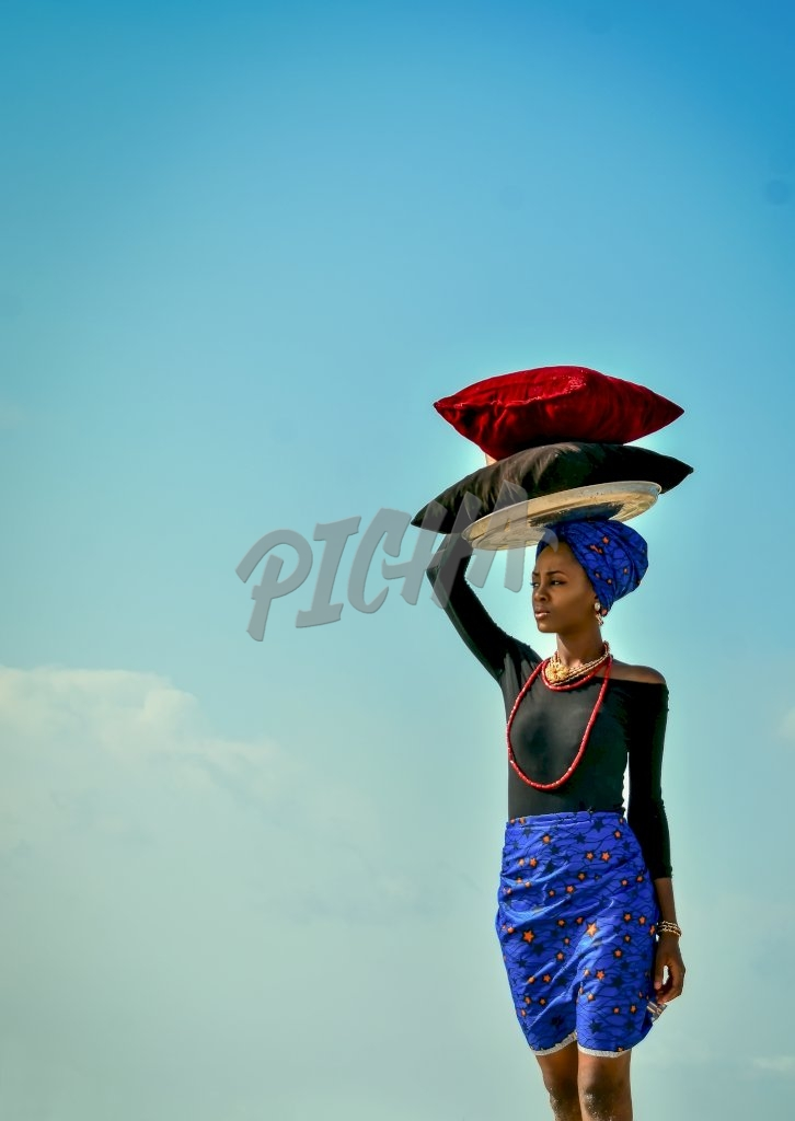 Woman carrying  on her head in Lagos, Nigeria