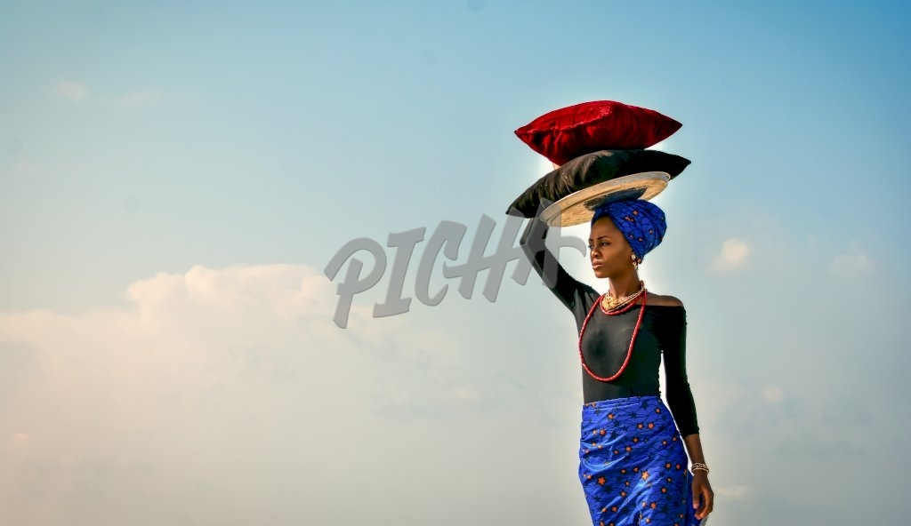 Woman carrying on her head