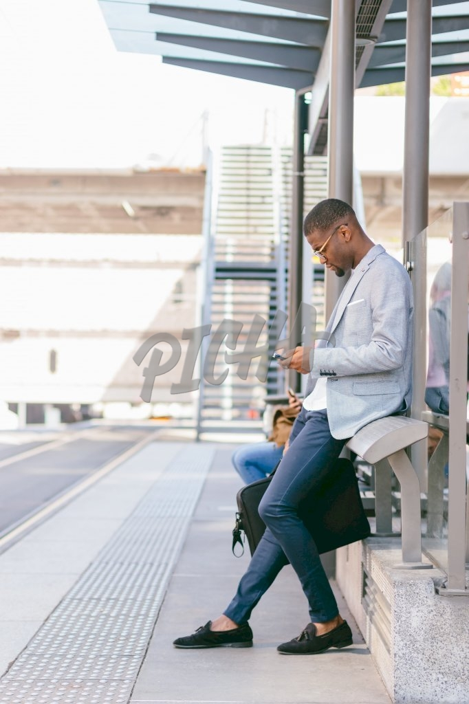 Business Man waiting for public transport in France