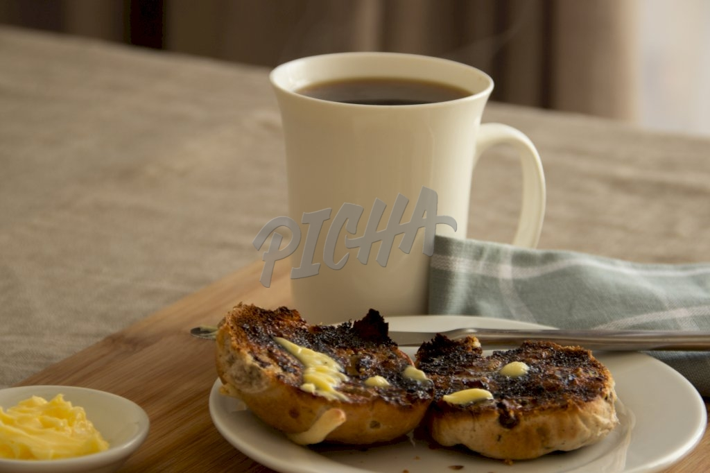 Toasted bun with butter and coffee