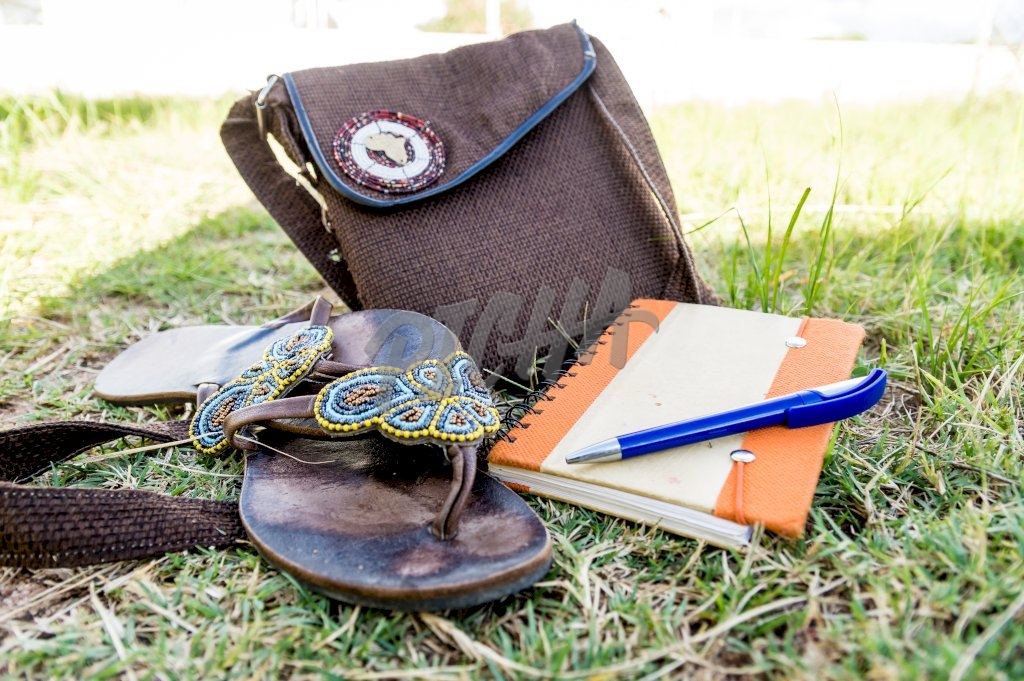 Sandals, a journal and bag for travel