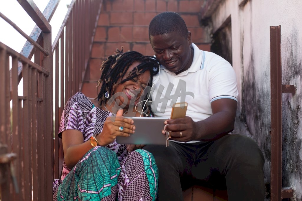Couple watching a video on a tablet in Libreville, Gabon