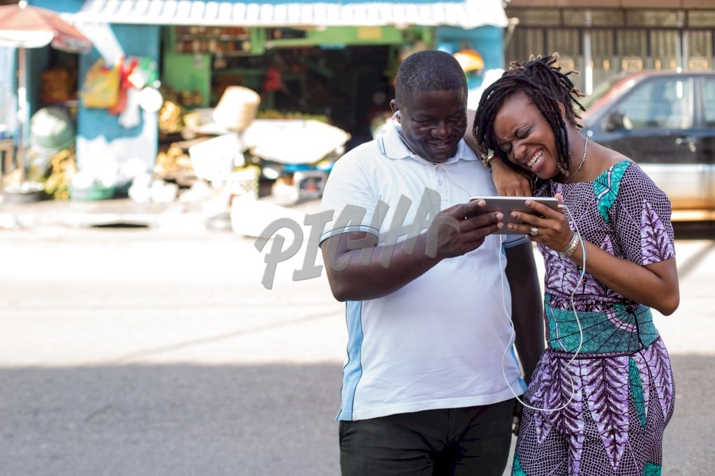 Couple watching a video on tablet in Libreville, Gabon