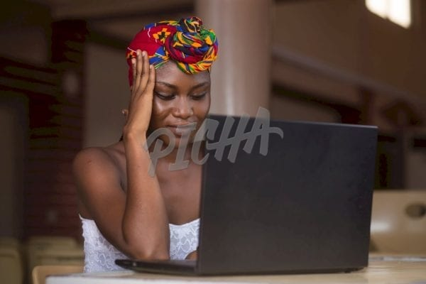 Woman working from her laptop in Accra, Ghana