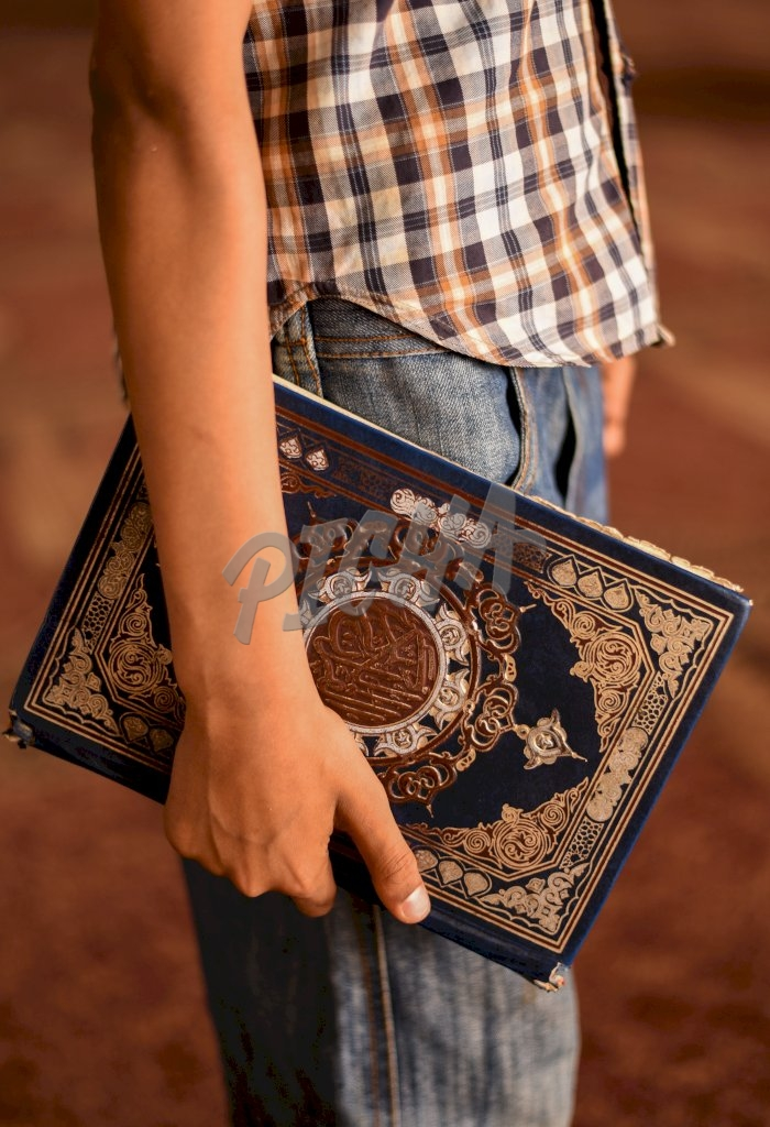 Holding the Quran in Cairo, Egypt
