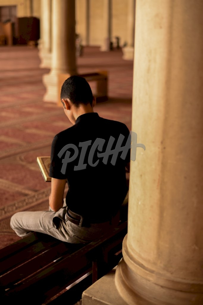Man reading the Quran in Cairo, Egypt