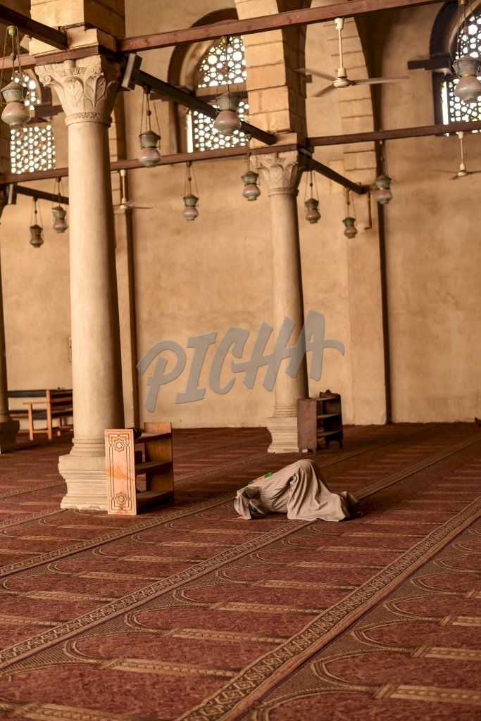 Man praying in a Mosque in Cairo, Egypt
