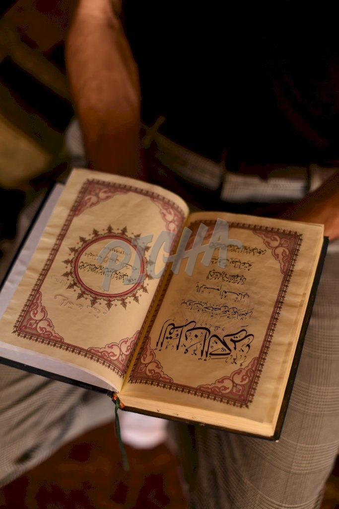 Man holding the Quran in Cairo, Egypt