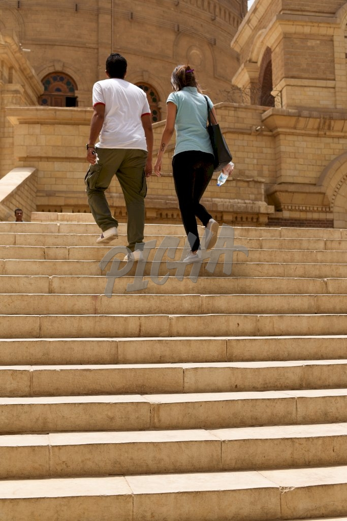 A couple getting up the stairs in Egypt, Cairo