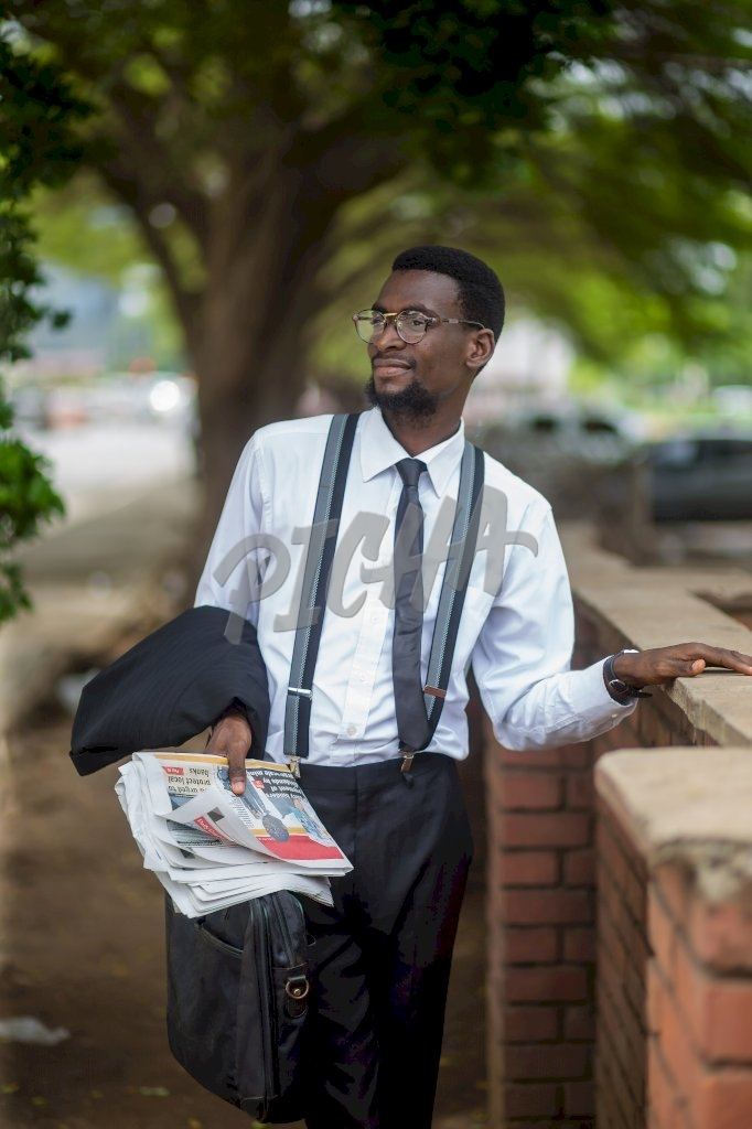 Business man standing in Accra