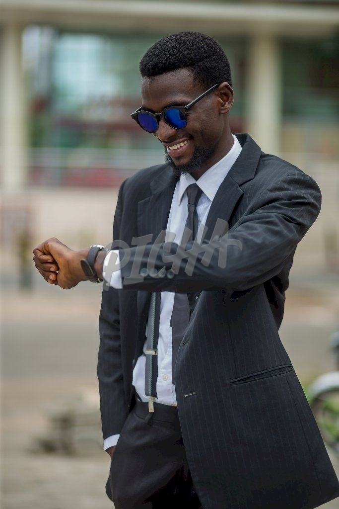 Business man checking the time