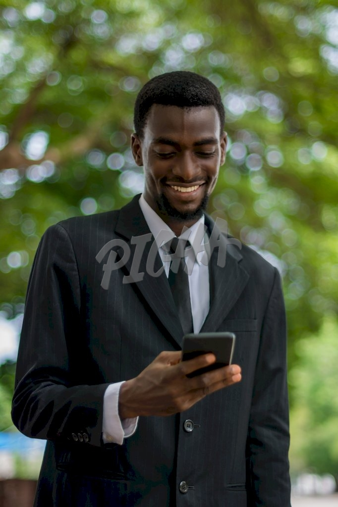 Business man holding his phone