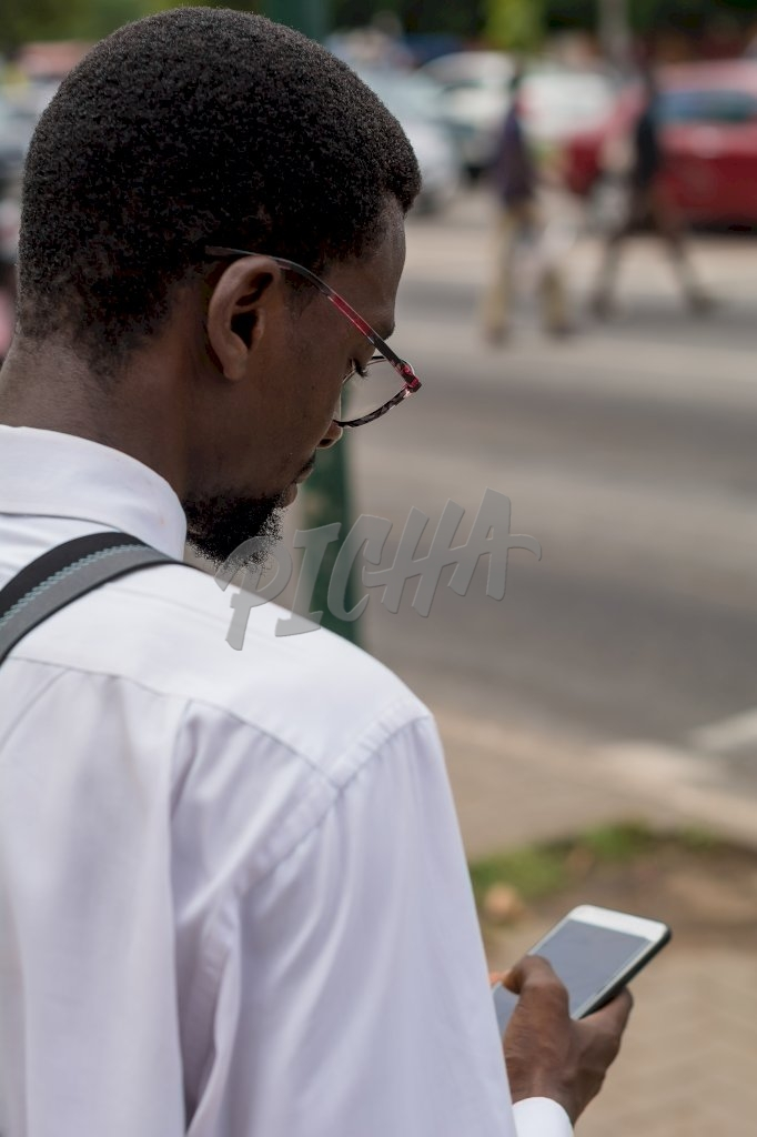 Business man checking is phone