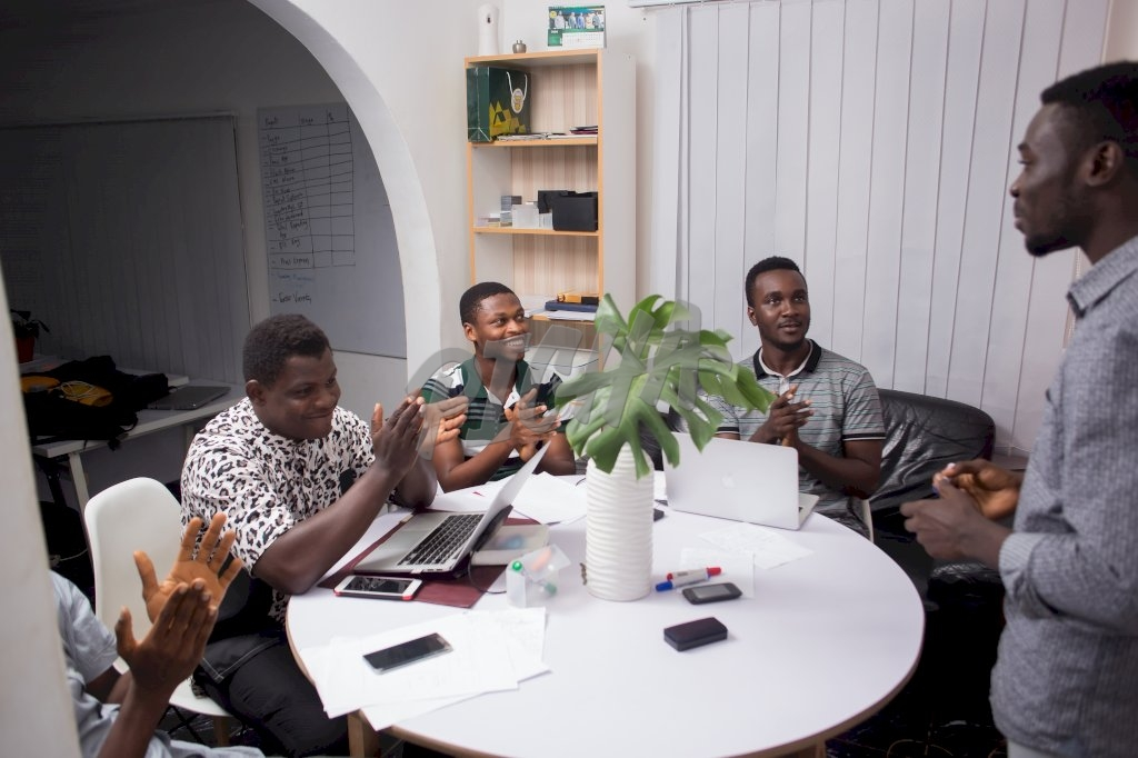 A group of men working in an office