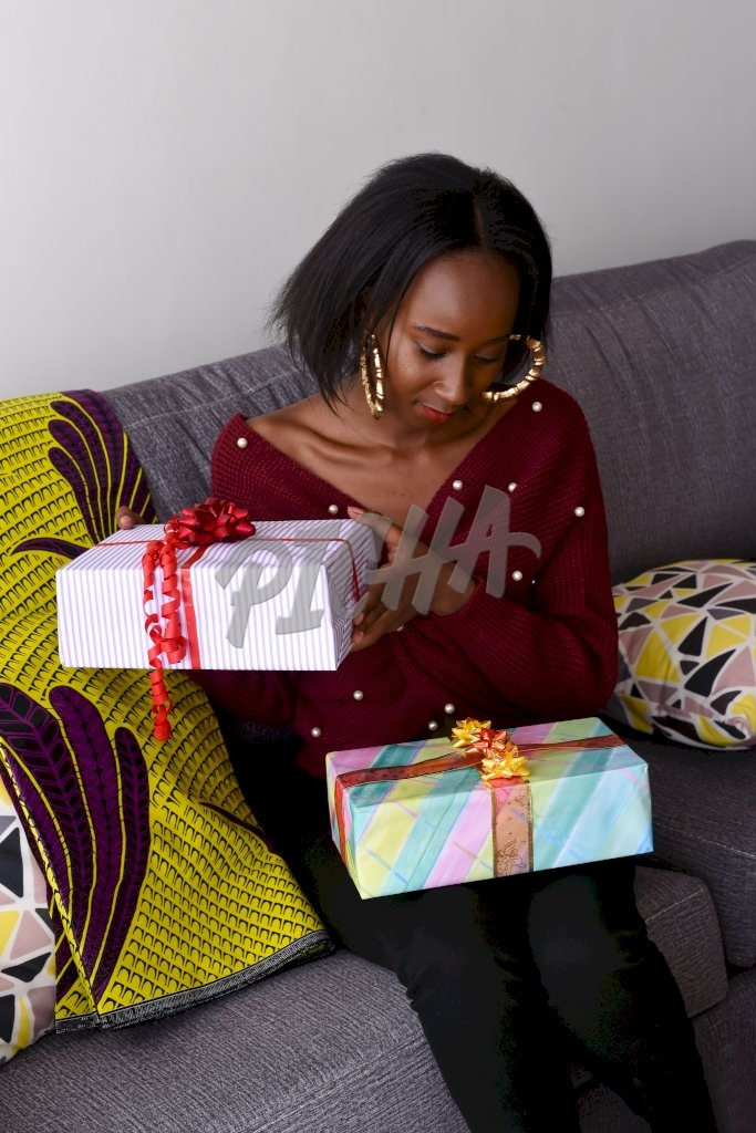 Woman holding gift boxes