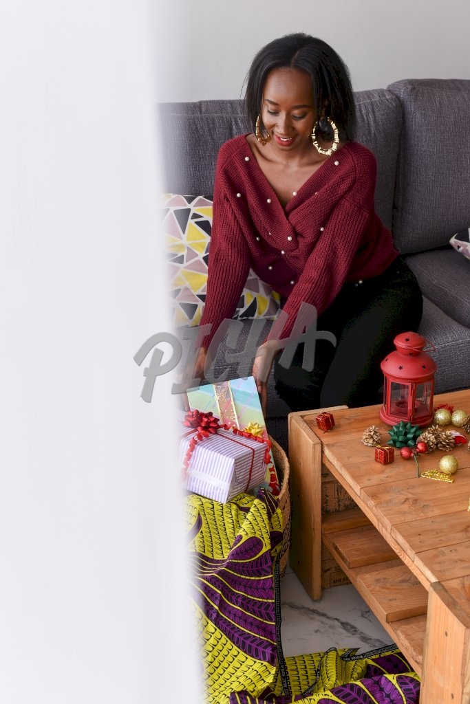 Woman adding gift boxes in a basket