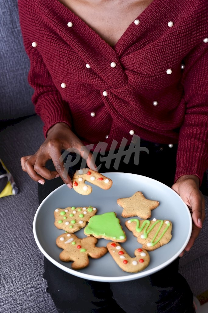 Woman grabbing a christmas cookie