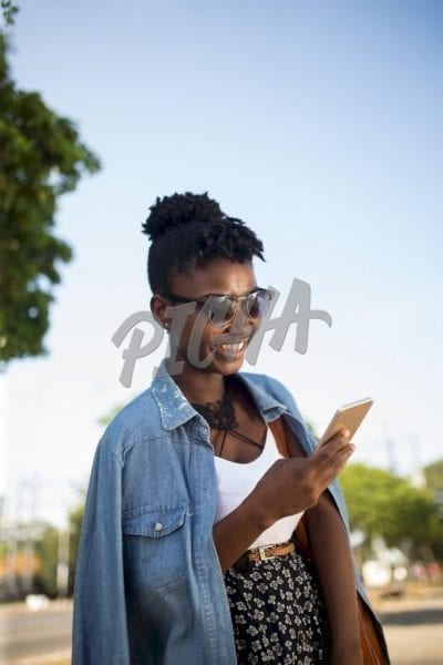Woman checking phone in Accra