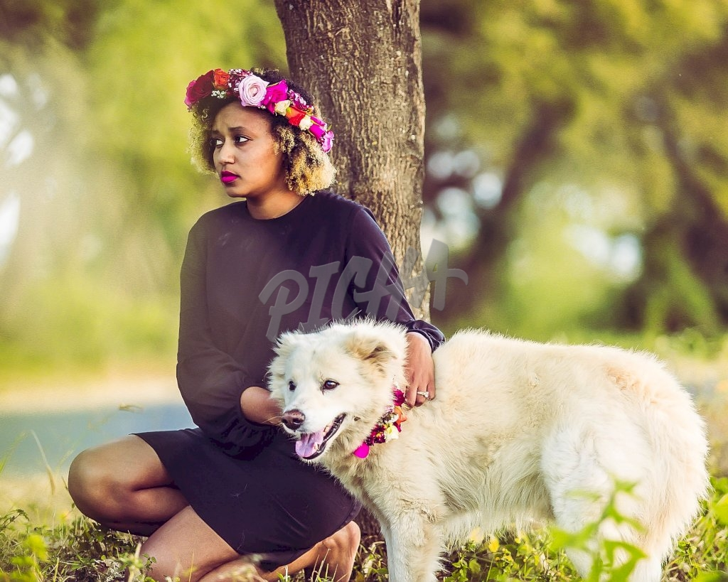 Women Having a good time with her dog