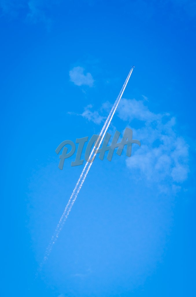 Airplane flying in the blue sky with white clouds